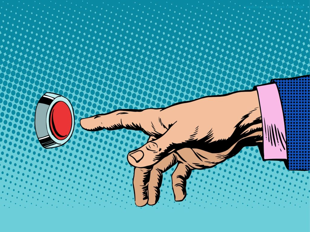 man's hand reaching for red button